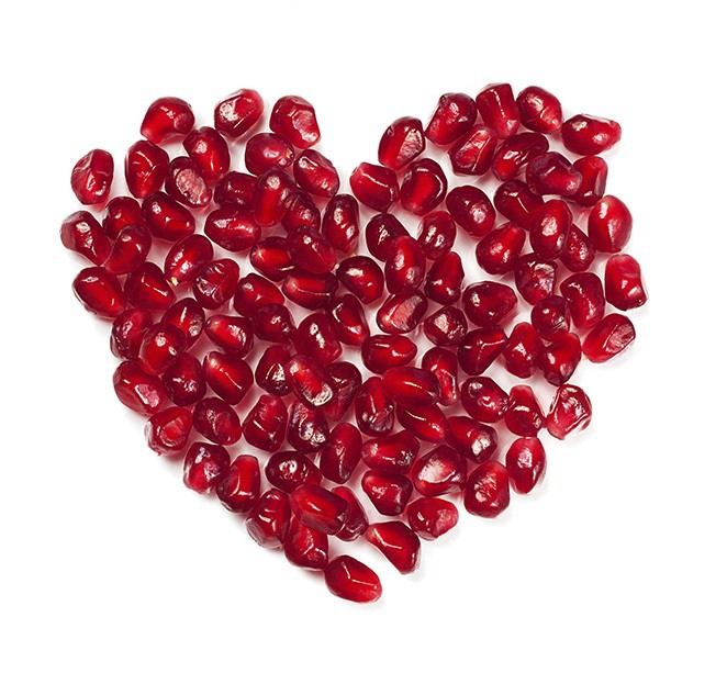 Pomegranate seeds shaped like a heart.